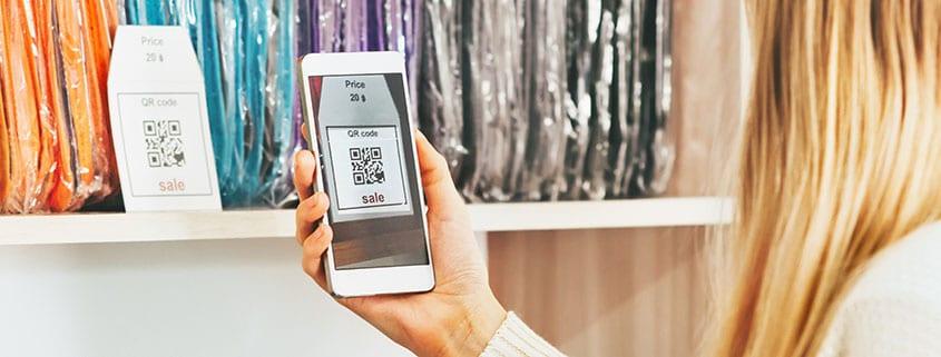 Woman scanning a QR code