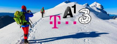 A group of people tour the alps with skis