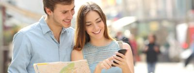 Tourists with smartphone and map:
