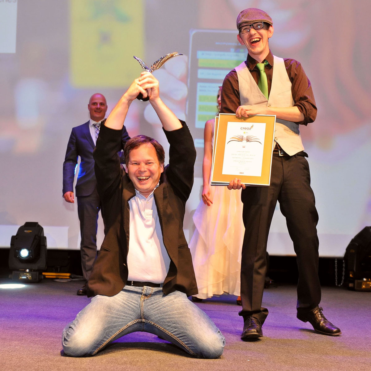 Georg and Bruno pose as winners of a CREOS award in gold