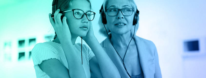 Two women listening to an audio guide